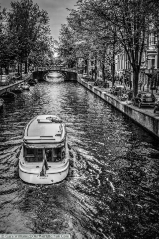 A motor-cruiser on one of Amsterdam's many canals, The Netherlands