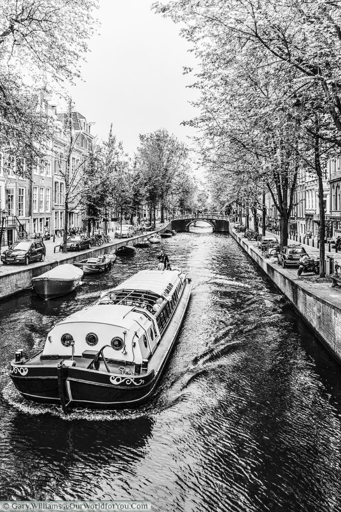 A party barge on the canals of Amsterdam, Amsterdam, The Netherlands