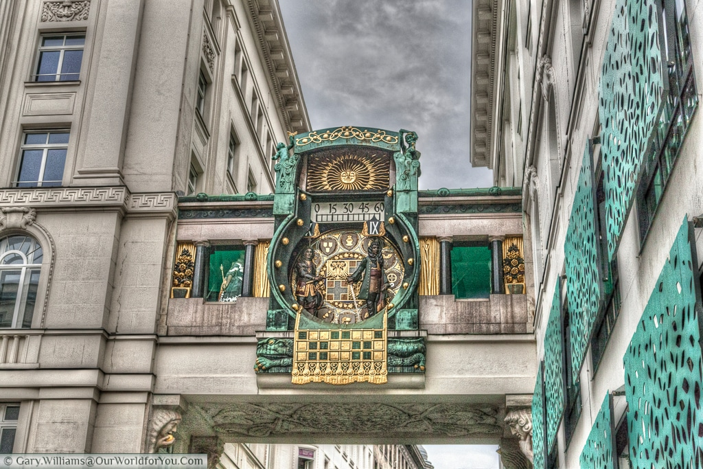 The Ankeruhr clock sits on one side of Hoher Markt in Vienna, Austria