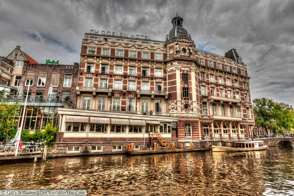 The imposing Doelen Hotel sits on in a prime location on the Amstel river, Amsterdam, The Netherlands