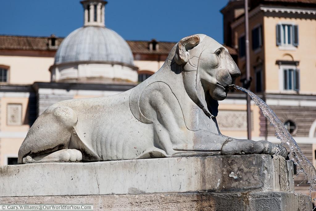 A lion statue in the Piazza del Popolo, Rome, Italy