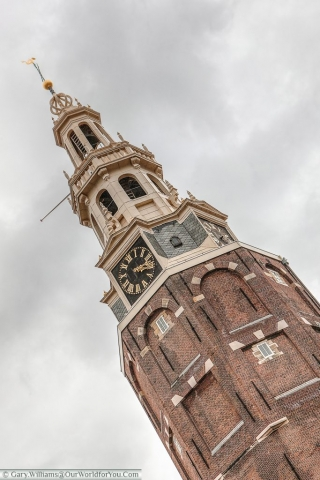 Montelbaanstoren - The imposing tower sits on the bank of the canal Oudeschans, Amsterdam, The Netherlands