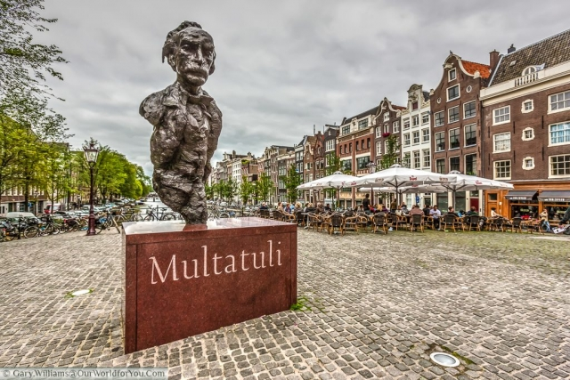 A monument to the writer Eduard Douwes Dekker on the Torensluis bridge across the Singel canal, Amsterdam, The Netherlands