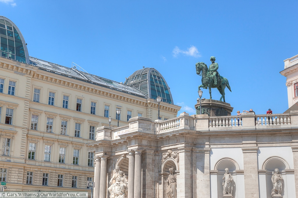 The corner of the Albertina Palace with an equestrian statue of Archduke Albrecht perched atop.
