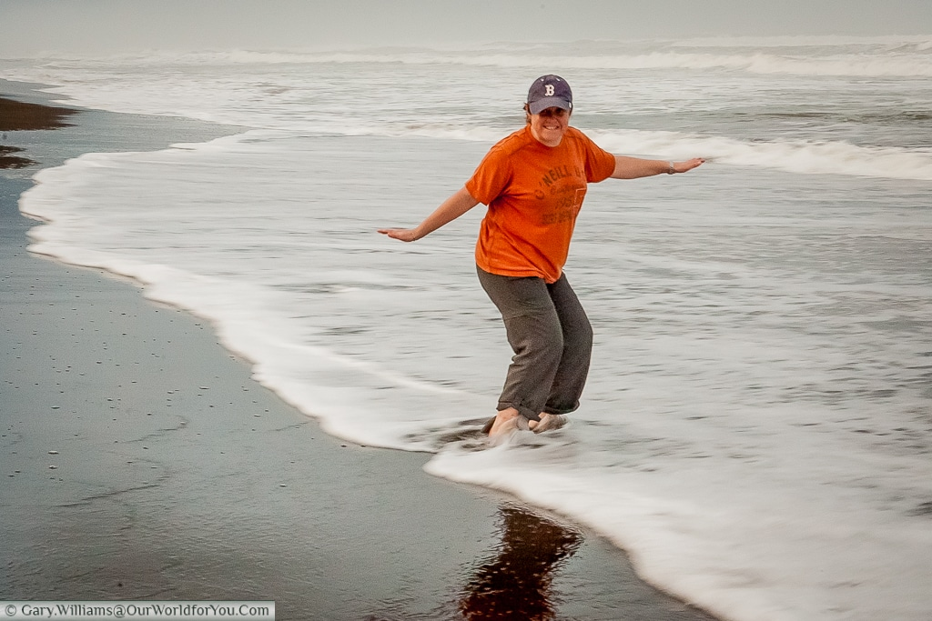 Janis dipping her toes in the Caribbean Sea at Tortuguero.