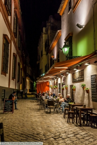 The quiet back lanes of Seville after the sun has set.
