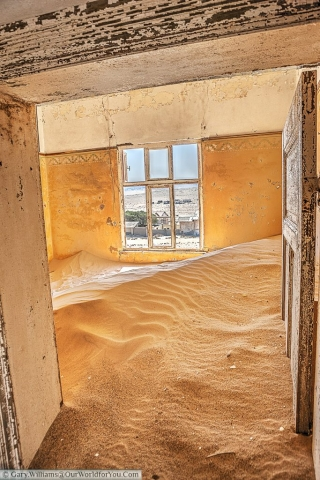 It won't be long before the sand flows out of the front of the building, , Kolmanskop, Namibia