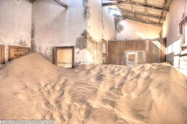 Sand dunes in the buildings of Kolmanskop, Namibia