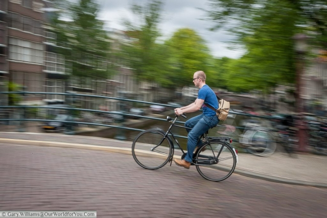 A cyclist, Amsterdam, The Netherlands