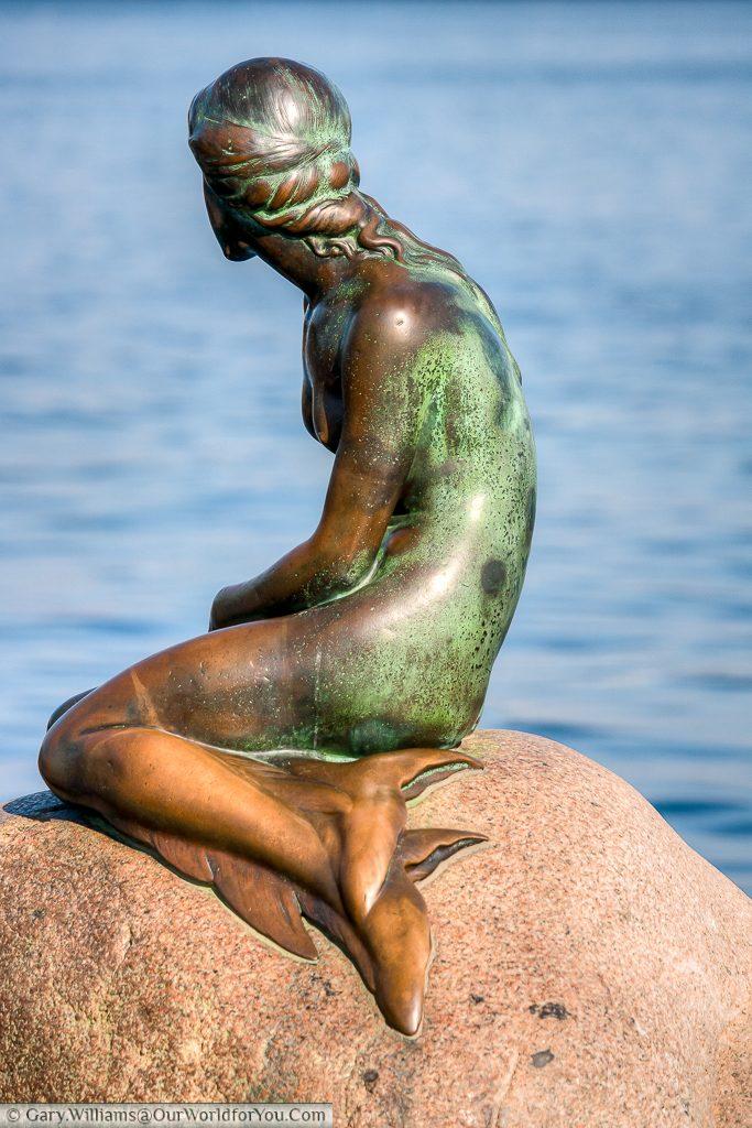 The Little Mermaid looking out to sea, Copenhagen, Denmark