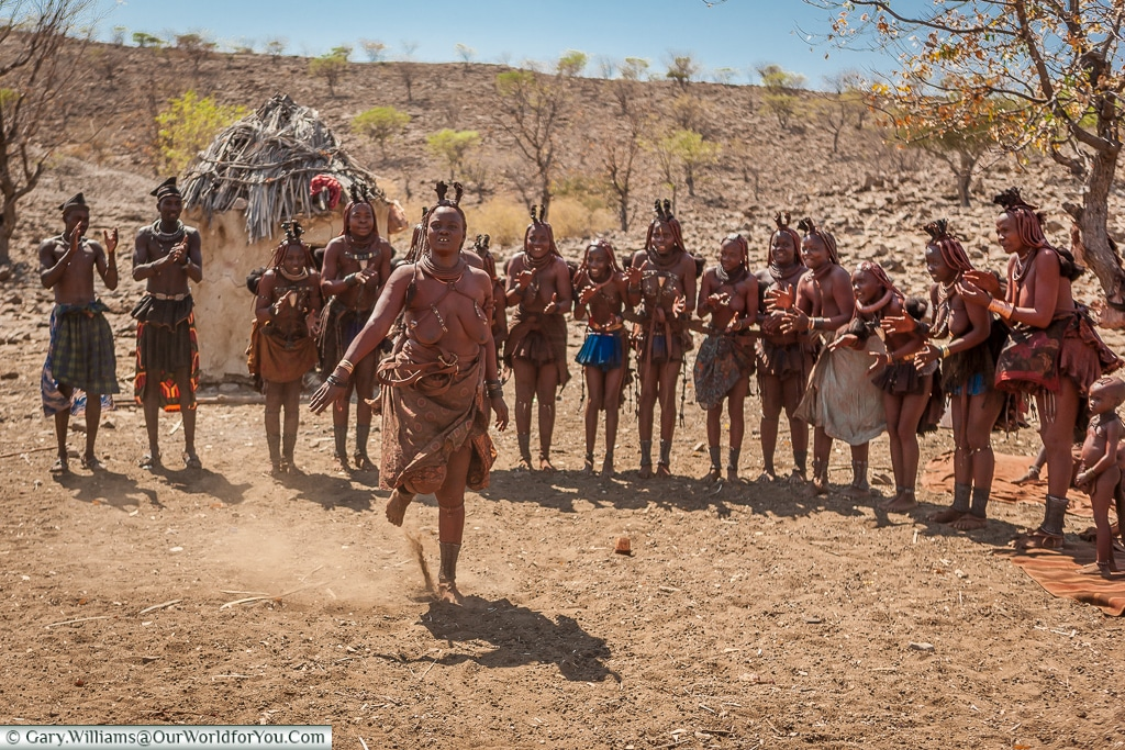 Kicking up the dust ,Himba-style, Damaraland, Namibia