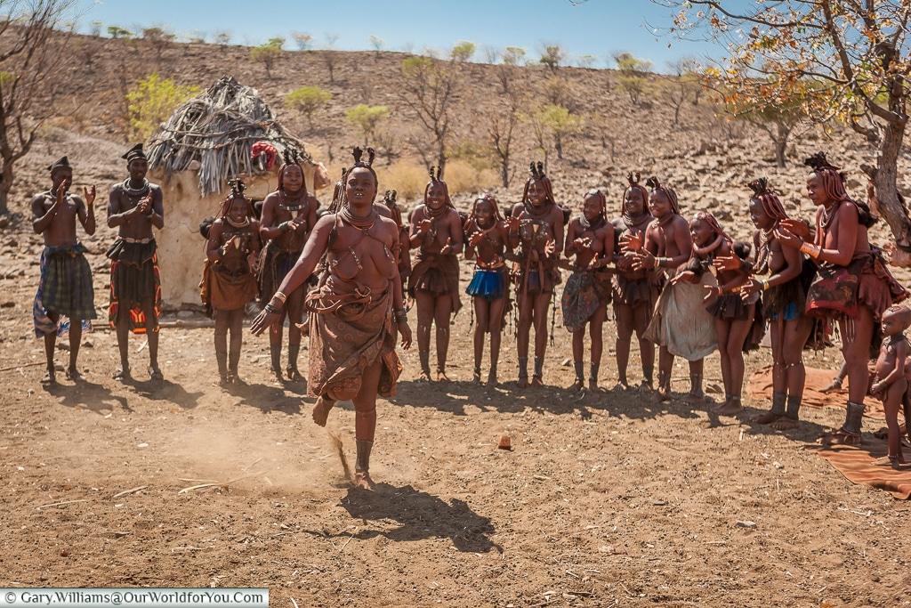 Kicking up the dust ,Himba-style, Damaraland, Namibia