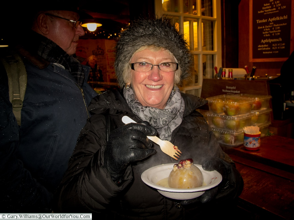 Mum enjoying a baked apple, Christmas Markets, Cologne, Germany