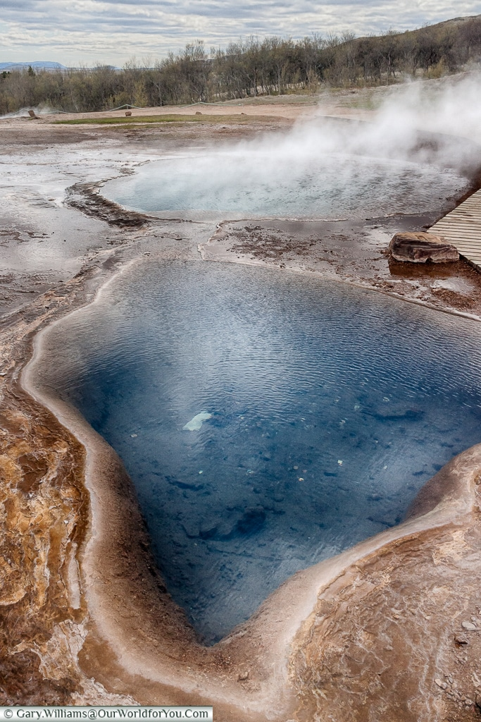 Deep pools in the Haukadalur geothermal region on the Golden Circle, Iceland