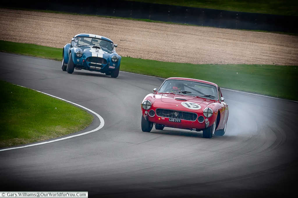 An AC Cobra chasing down a Ferrari, Goodwood Revival, UK