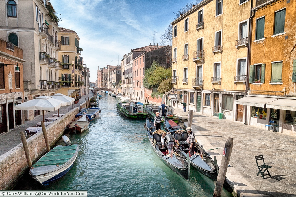 Gondoliers on the canals, Venice, Italy