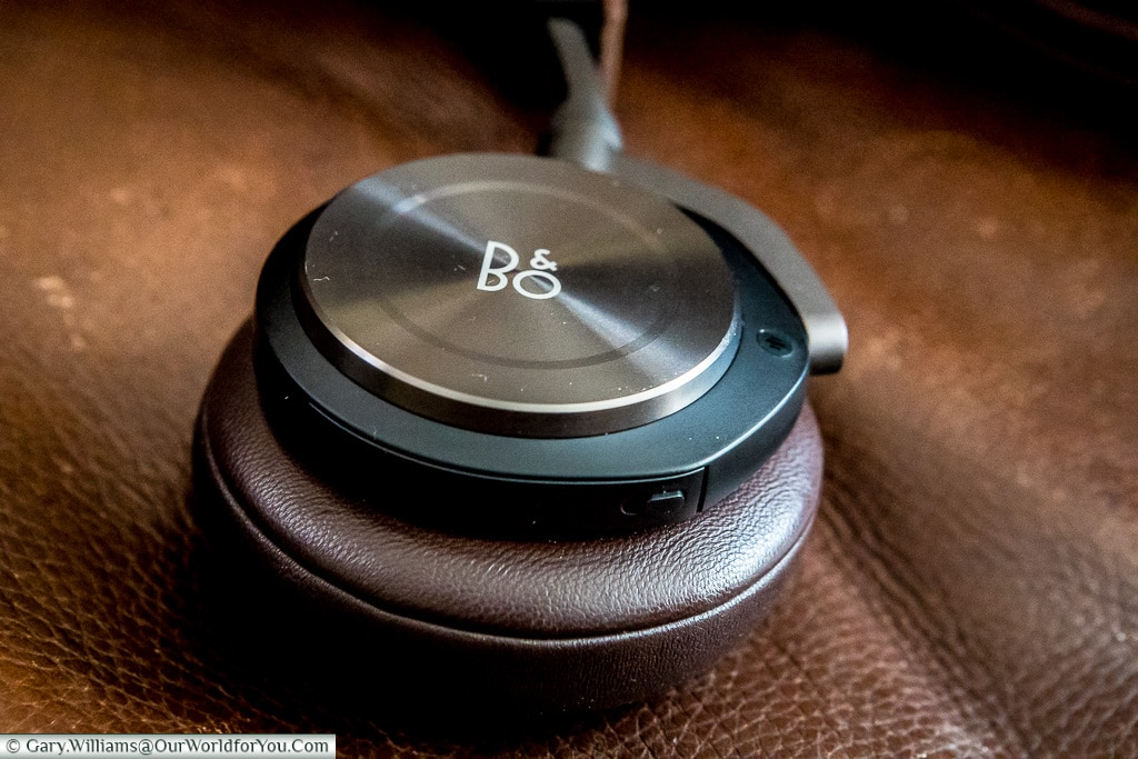 The B&O logo, or Bang and Olufsen, H8 Headphones