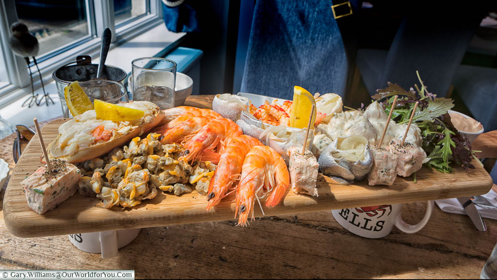 A seafood platter for two served on a wooden board at the Wells Crab House in Wells-next-the-Sea, Norfolk