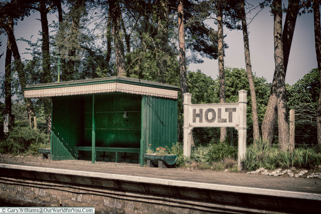 A vintage shelter, in a green & cream paint scheme, at Holt station on the  North Norfolk Railway line.