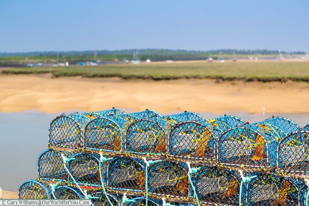 Shellfish baskets stacked up on the quayside of Wells-next-the-Sea on the North Norfolk coastline