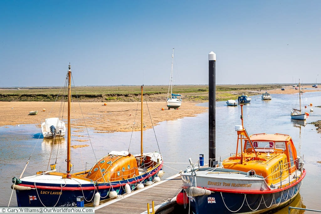 A pair of historic Lifeboats moored up at Wells-next-the-Sea on the North Norfolk coastline