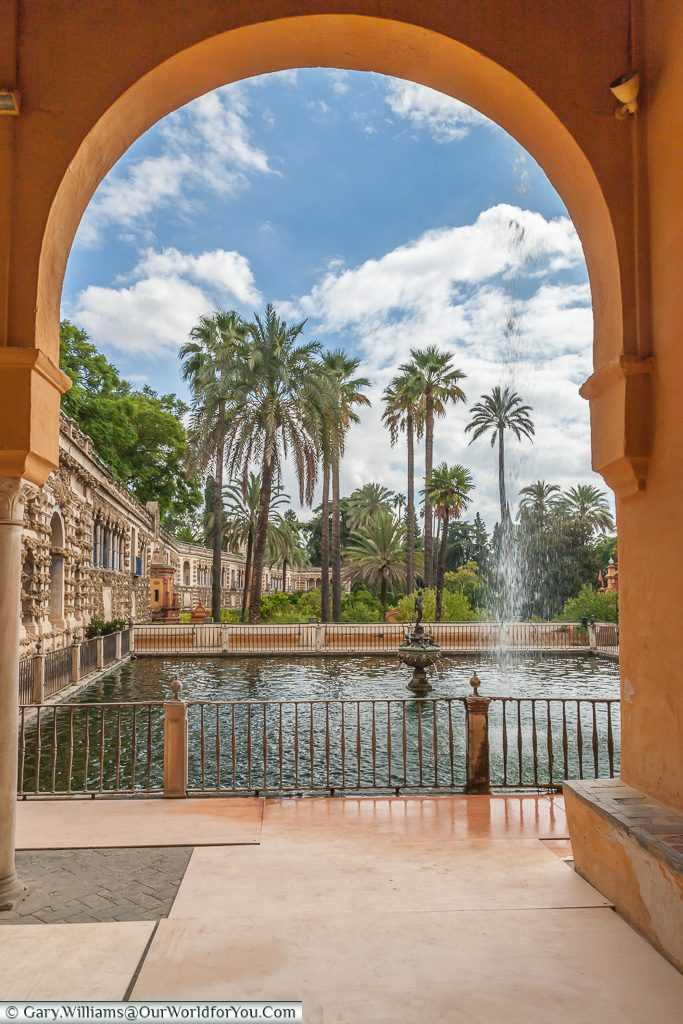 A view of the gardens of the Alcázar, Seville, Andalusia, Spain
