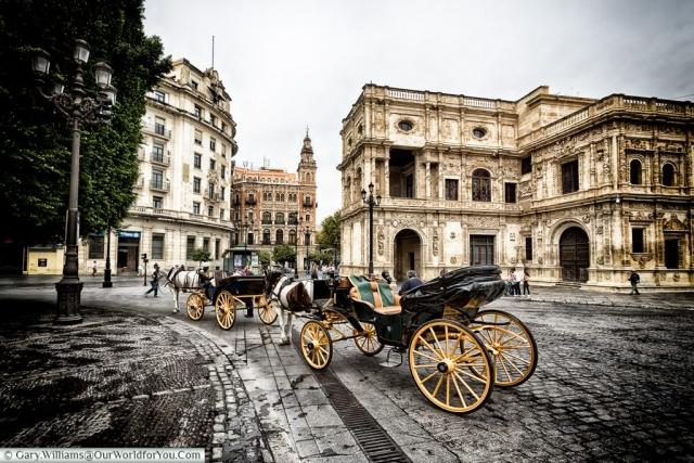 Awaiting a fare infron of the Ayuntamiento de Sevilla, Seville,