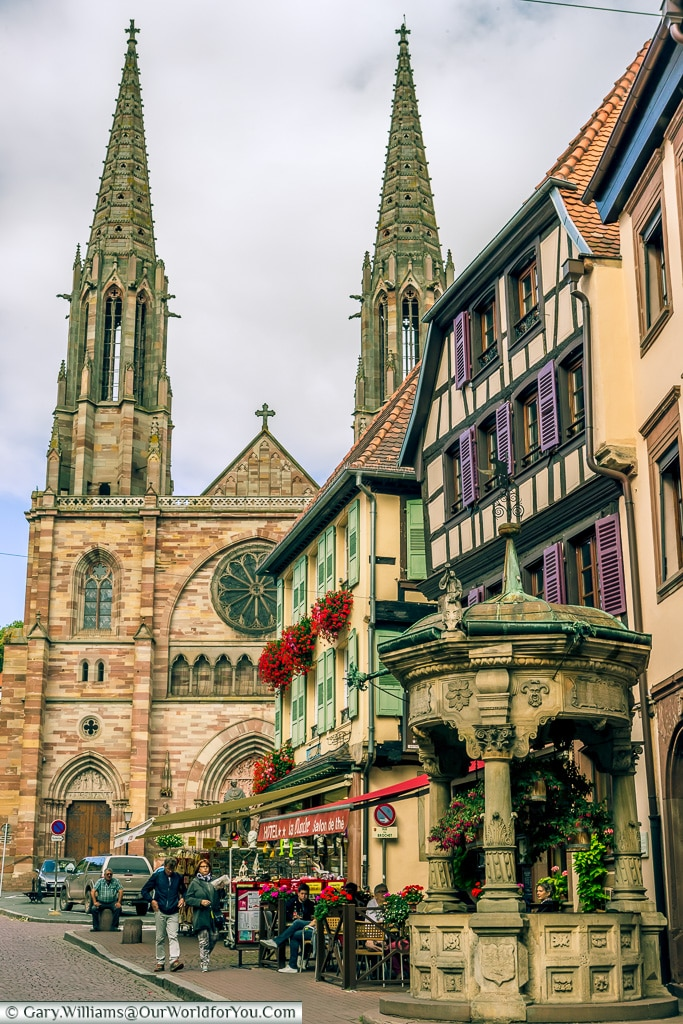 Six Buckets Well with the Church of Saints Peter and Paul in the background, Obernai, Alsace, France