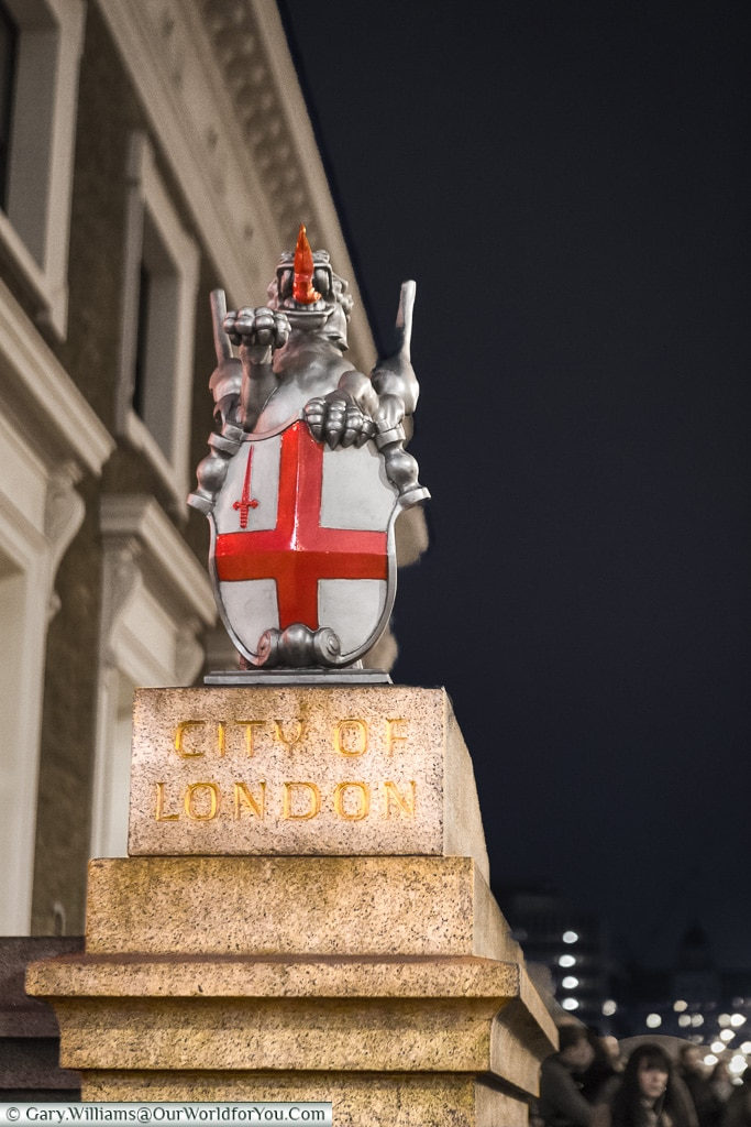 The City of London crest on the London Bridge Entrance to the City of London, London, England, UK