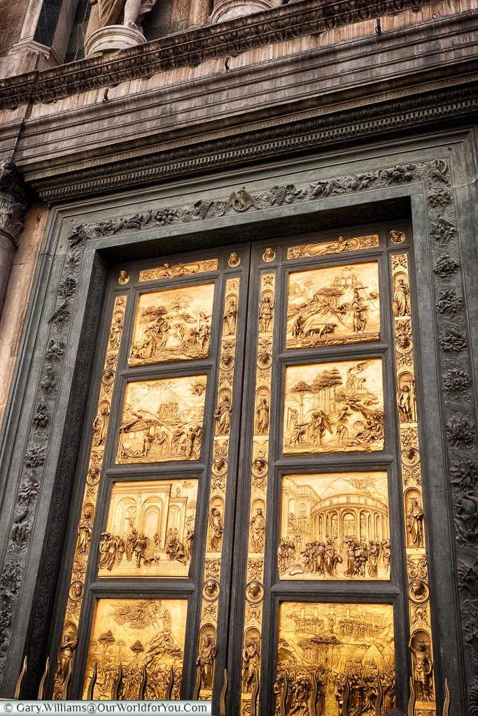 An intricate door on the Baptistery of St. John, Florence, Tusca