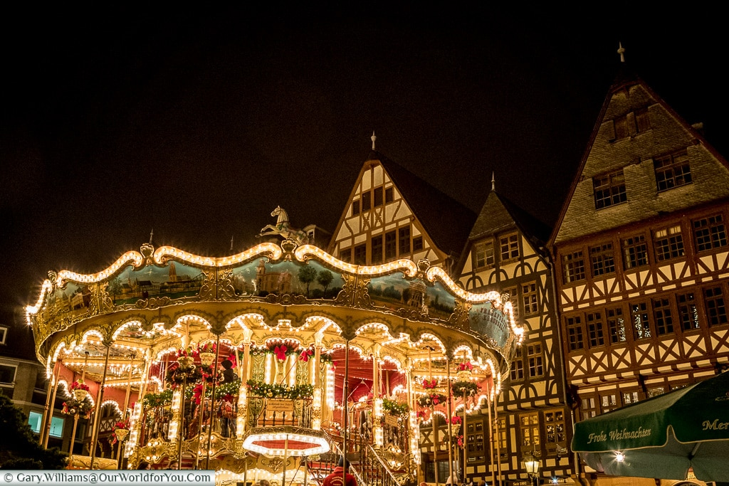 The brightly lit carousel in Frankfurt's Römerberg Christmas market