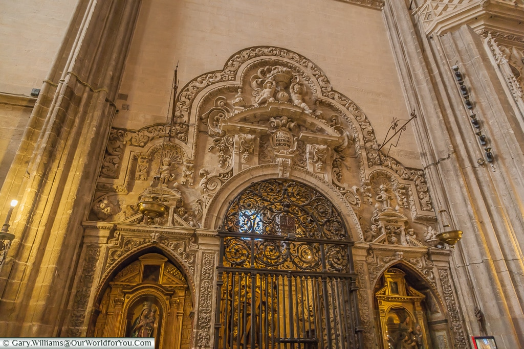 An ornate entrance to one chapel, Seville Cathedral, Seville, Spain