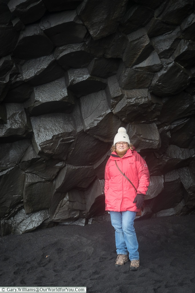 Janis next to the rock formation at Reynisfjara Beach, Iceland