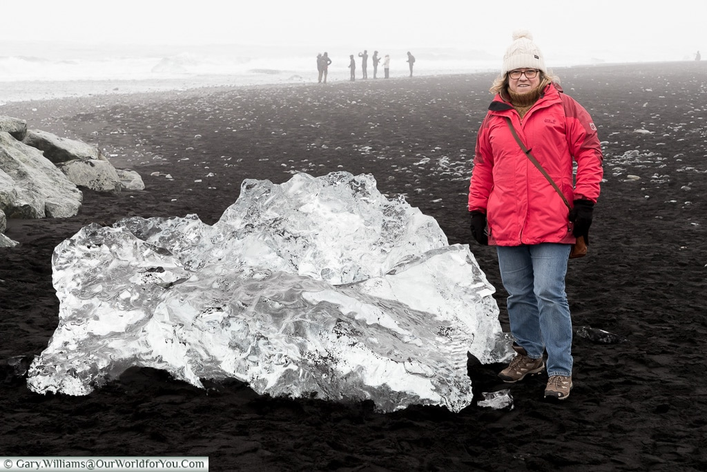 Janis with a big diamond on the beach, Iceland