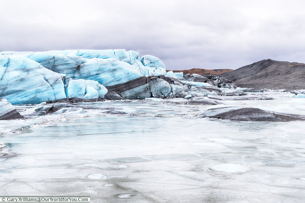 The layers of ice and ash trapped within the Svínafellsjökull glacier, Iceland