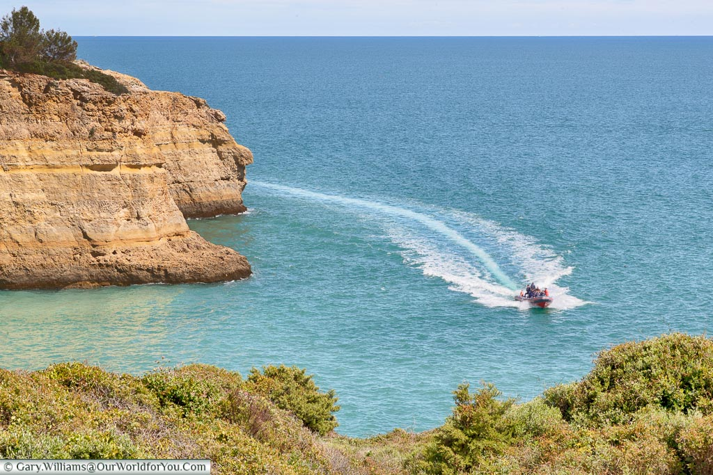 A speedboat off Praia de Benagil, Algarve, Portugal