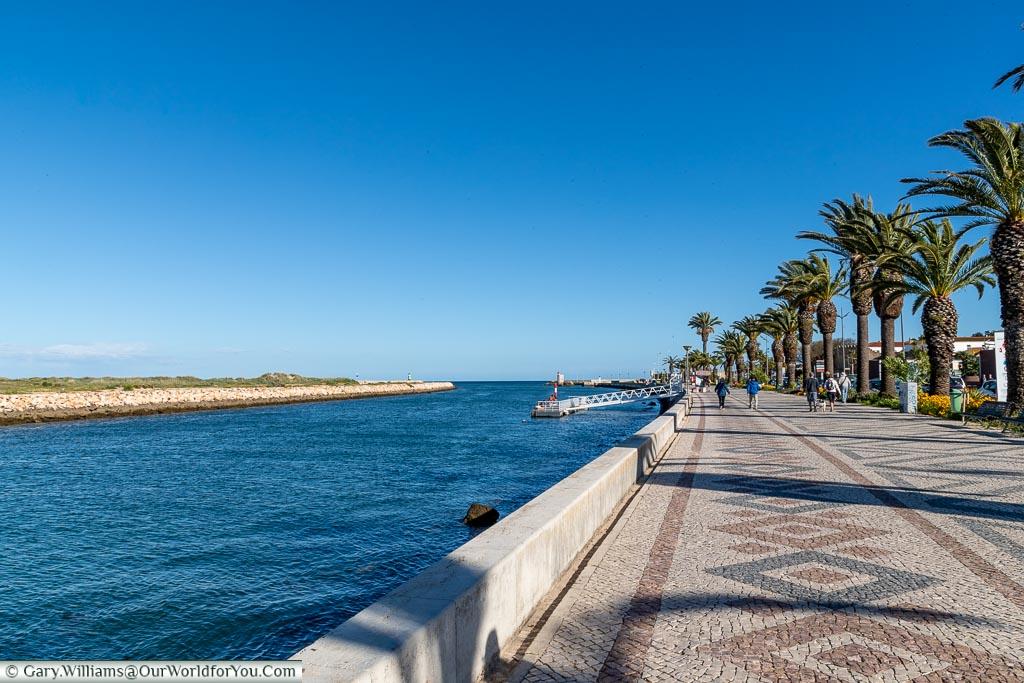 Strolling along the promenade in Lagos, Algarve, Portugal