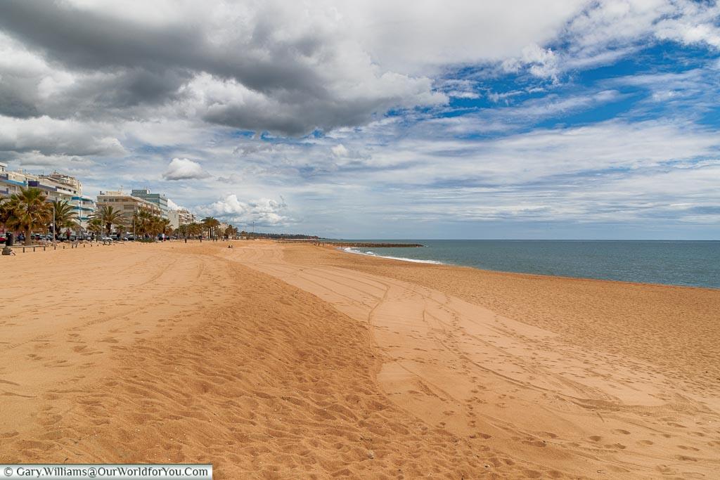 The golden sands of Quarteira, Argarve,  Portugal