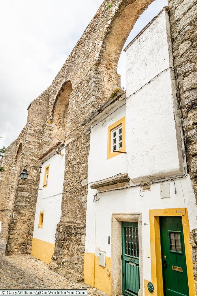Homes built into the aqueduct, Évora, Portugal