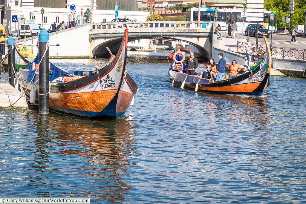 Moliceiros floating along, Aveiro, Portugal