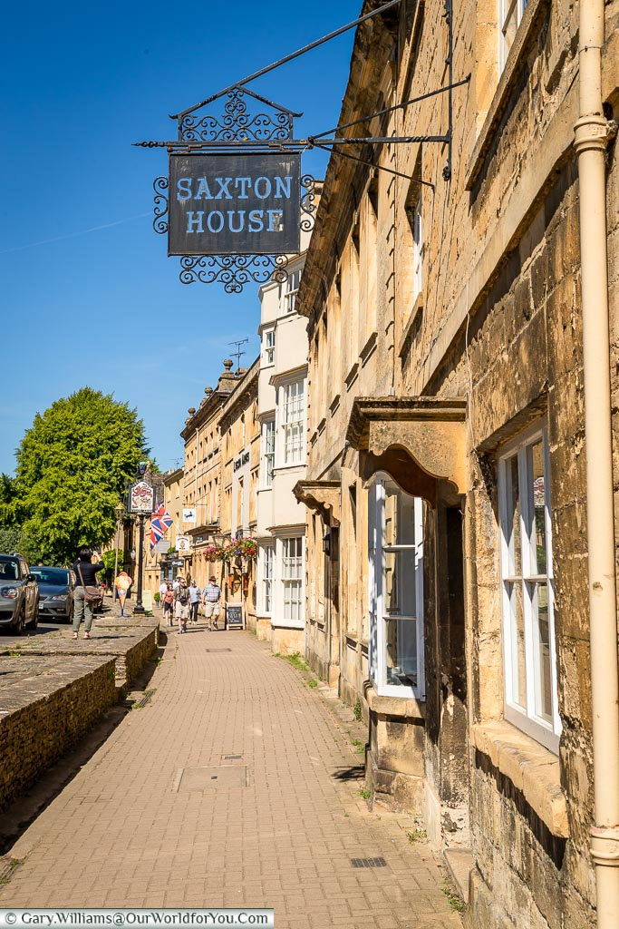Strolling along the High Street, Chipping Campden, Gloucestershire, England, UK