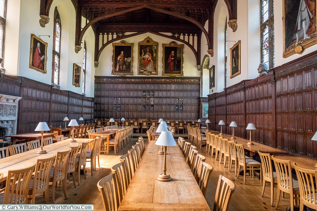 A wood-panelled communal dining hall of Magdalen College, Oxford