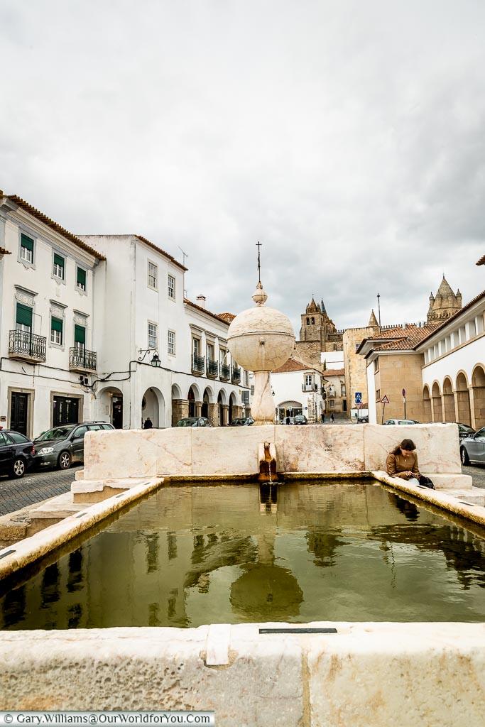 The fountain in the Largo de Porta Moura, Évora, Portugal