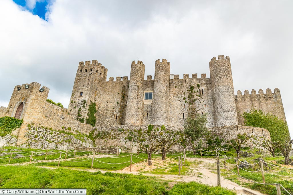Looking up at the castle, Óbidos, Portugal