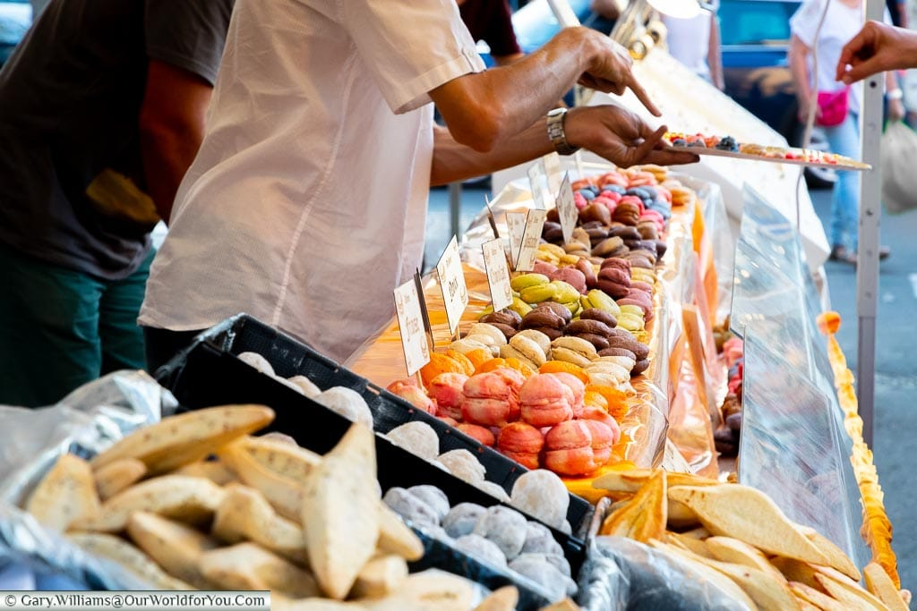 A close up the selection of macaroons on sale at the local market of Saint Remy de Provence