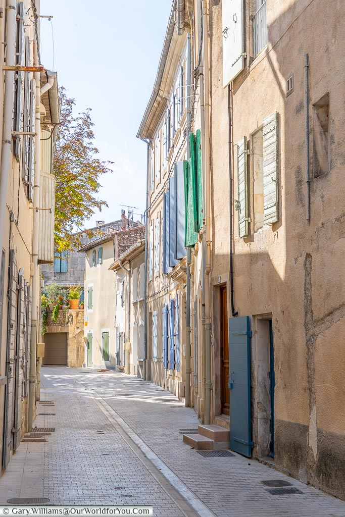 A quiet backstreet of 3 storeys shuttered buildings in Saint Remy de Provence