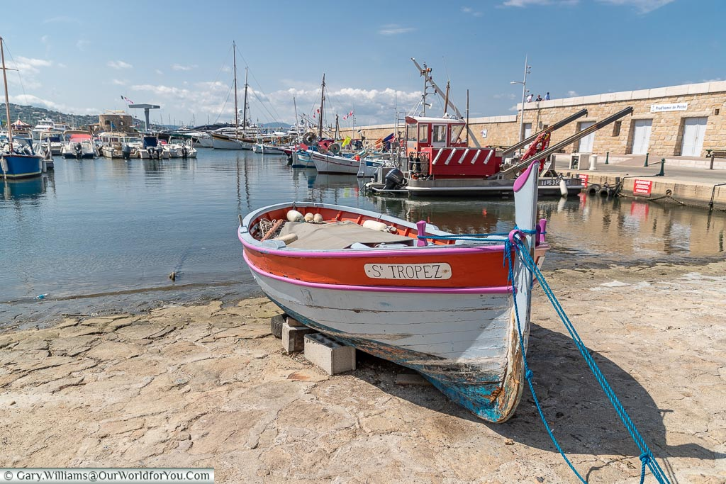 An old wooden fishing boat moored up the harbour of Saint Tropez on the French Riviera