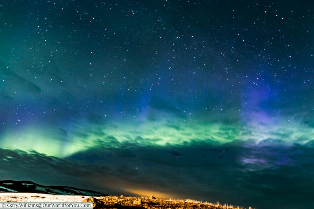 The many colours of the Northern Lights at Reykjahlíð, Eastern Iceland