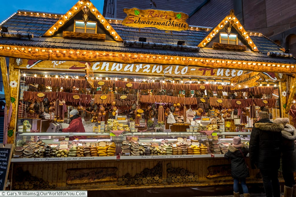 A Christmas market stall selling sausages and nothing but sausages.