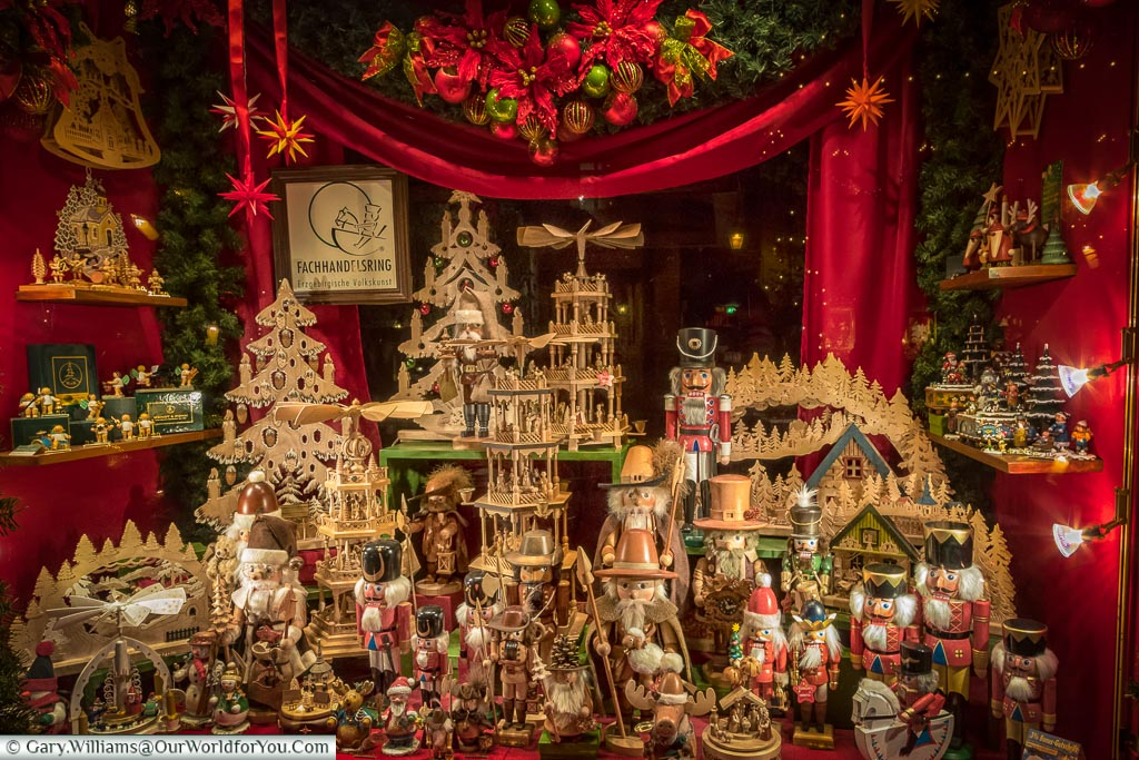 A traditional Christmas window display in Rothenburg ob der Tauber.  Full of traditional nutcrackers, Christmas pyramids and advent trees,
